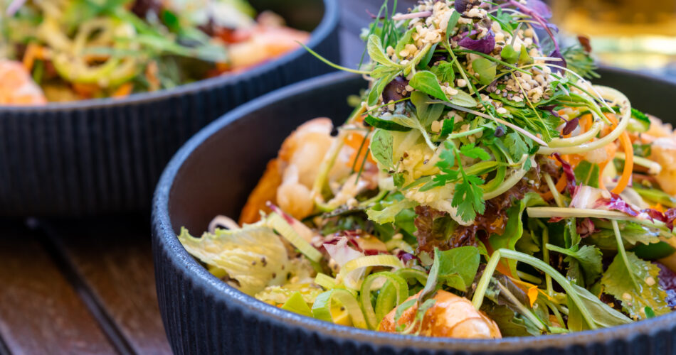 A close up view of delicious and healthy summer greens salad with shrimp