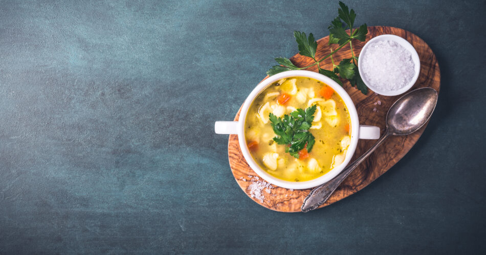 Chicken soup with noodles and parsley
