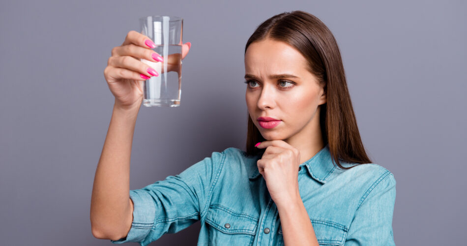 Close up portrait of not sure in quality of water she her woman girl wearing casual jeans shirt outfit clothes isolated on grey background