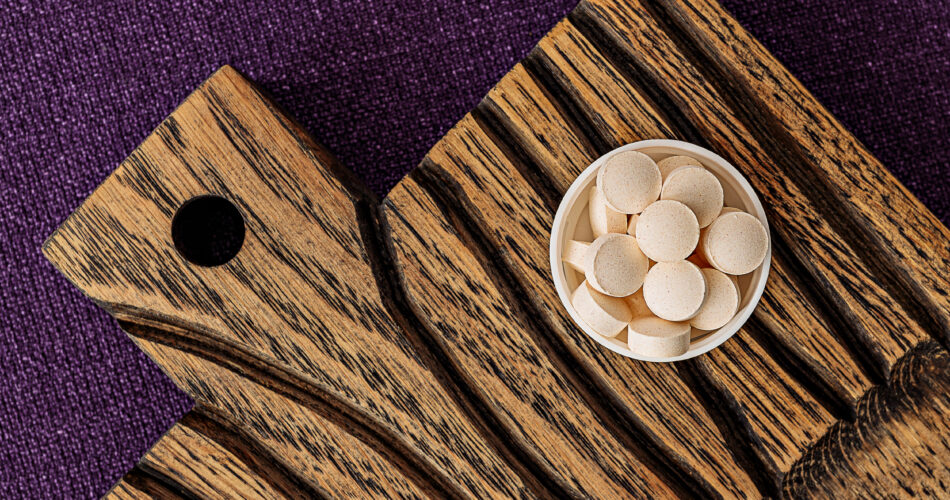 glutathione complex supplement pills on a wooden desk. dietary supplements top view. mental wellbeing and personal health concept