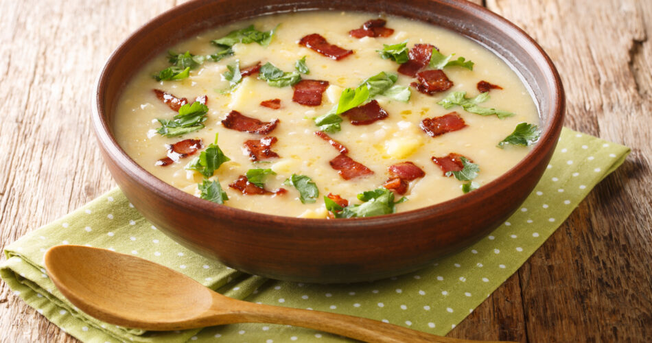 Homemade Rumfordsuppe Pea and Pearl Barley Soup recipe with bacon closeup in a plate on the table. horizontal