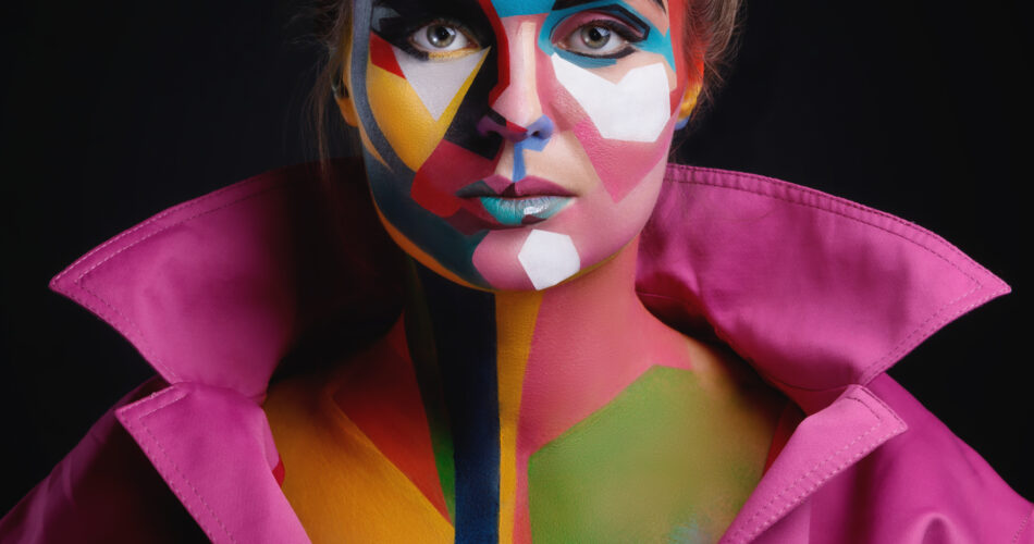 Model with a creative pop art make-up on her face in image of cartoon or comics character