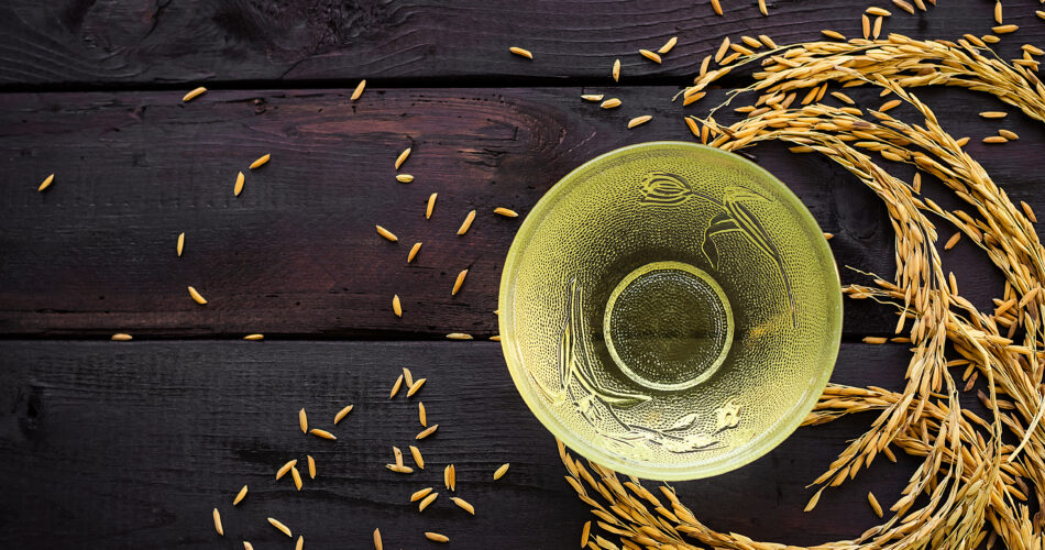 Rice bran oil in glass on wooden background. food for health concept.