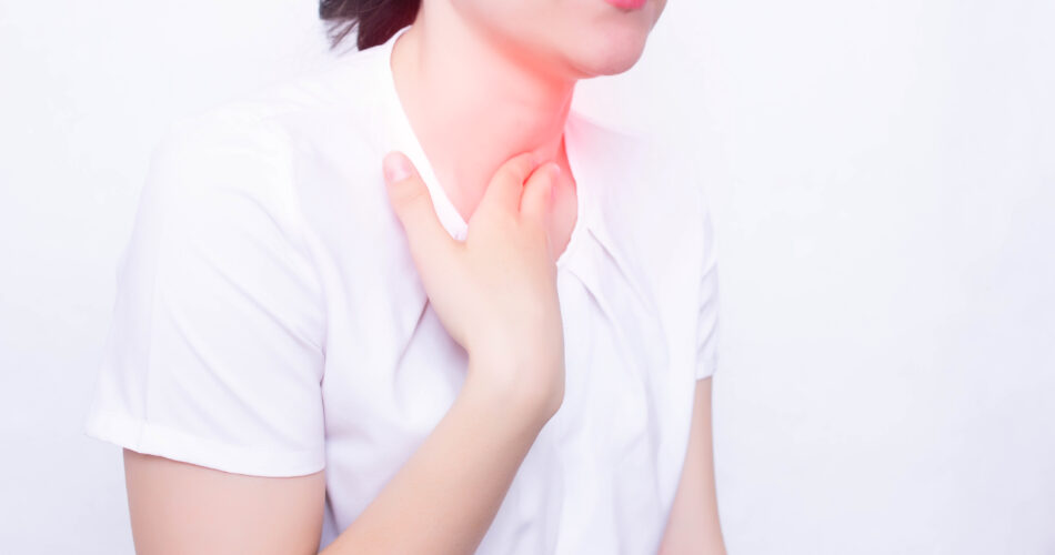 Young caucasian girl on a white background whose pain and inflammation in the throat concept of pharyngitis and laryngti throat diseases, infectious diseases, streptococcus