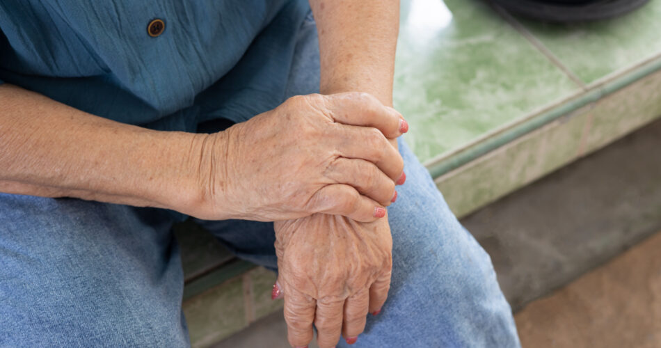 Seniors hands with feeling pain for her hands and arms which might be the elderly diseases such as guillain-barre syndrome and rheumatoid occurring due to nervous system and muscle weakness.