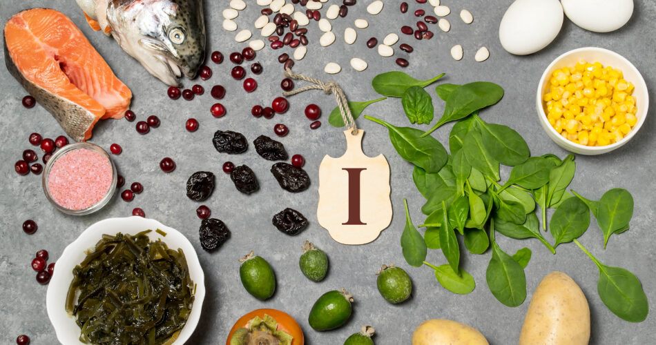 Food is source of iodine. Various food rich in vitamins and micronutrients. Useful food for health and balanced diet. Prevention of avitaminosis. Small cutting board with name of iodine. Top view