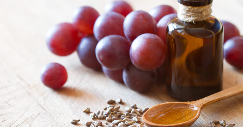Grape seed oil for skin and hair care background concept