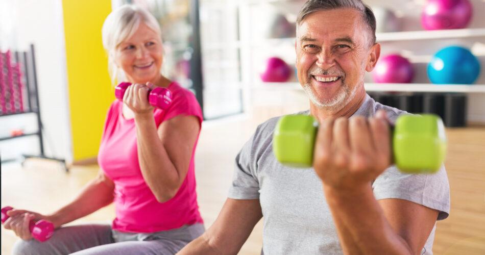 Senior couple lifting dumbbells